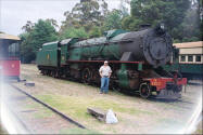 Ray Pasnen in front of a locomotive steam engine - pic.